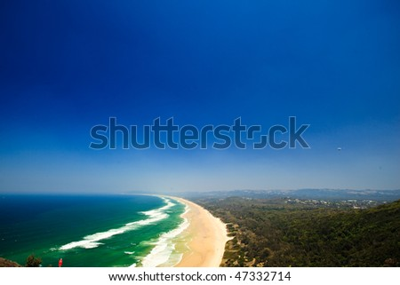 Panoramic View of Pristine Byron Bay Beach and Surrounding Hills.