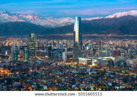 Panoramic view of Providencia and Las Condes districts with Costanera Center skyscraper, Titanium Tower and Los Andes Mountain Range, Santiago de Chile Сток-фото ©