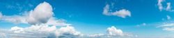 Panoramic View of Puffy White Clouds with Blue Sky during a beautiful Sunny Day. Taken over Vancouver, British Columbia, Canada. Nature Background Panorama