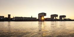 panoramic view of Rheinauhafen, Cologne, at sunset