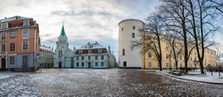 Panoramic view of Riga Castle during sunny winter snowy day in Riga, Latvia. Riga Castle is a castle on the banks of River Daugava. Today it is the official residence of the President of Latvia.