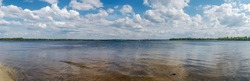 Panoramic view of river bed. Photo was taken from sandy shore of island, which is in middle of the river