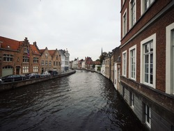 Panoramic view of river canal channel in historic city center of Bruges West Flanders Flemish Region Belgium Europe