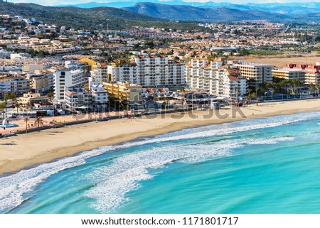 Panoramic view of sandy beach, coastline and cityscape of Peniscola. Popular, famous travel destinations for vacationers, travelers and tourist. Turquoise Mediterranean Sea. Costa del Azahar. Spain #1171801717