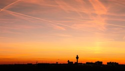 Panoramic view of Schiphol International Airport at sunset. Amsterdam, The Netherlands