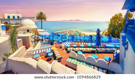 Panoramic view of seaside and cafe terrace in Sidi Bou Said at sunset. Tunisia, North Africa   #1094866829
