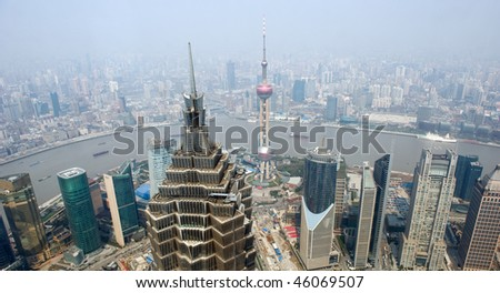 panoramic view of shanghai in China,  overlook pudong, huangpu river, puxi, jinmao tower and the oriental pearl Tower.