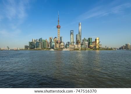 panoramic view of shanghai skyline with huangpu river  #747516370