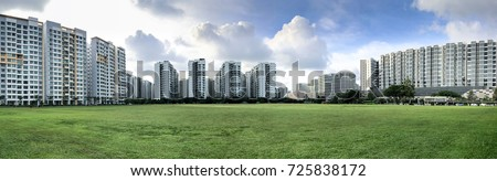 Panoramic view of Singapore Public Housing Apartments in Punggol District, Singapore. Housing Development Board(HDB) on green grass field