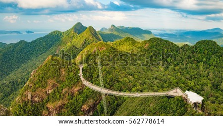 Panoramic view of Sky Bridge and Cable Car with mountains, sea and tropical forests in the background, Langkawi island, Malaysia. Langkawi SkyCab is one of the major attractions in the island. #562778614