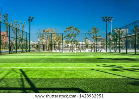 Panoramic view of soccer field stadium and stadium seats #1428932951