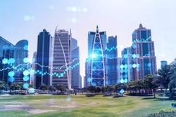 Panoramic view of steel and glass skyscrapers of Dubai Marina. Modern cityscape of the capital of the UAE. Financial services hub. FOREX graph and chart concept. Double exposure.