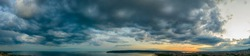 Panoramic view of stormy cloudy sky over the sea.