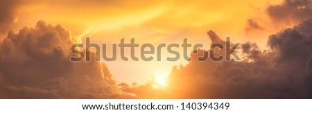 panoramic view of sunset sky with dramatic clouds and sun