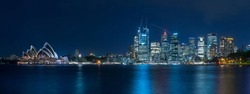 Panoramic view of Sydney city and bridge at night with beautiful reflection.Long exposure shot.