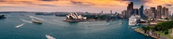 Panoramic View of Sydney Skyline with Opera House at Sunset from Harbour Bridge