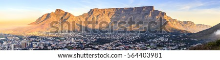 Panoramic view of Table Mountain in Cape Town, South Africa at sunset
