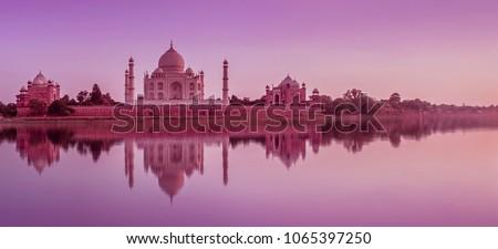 Panoramic view of Taj Mahal during sunset reflected in the Yamuna river, in Agra , Uttar Pradesh, India #1065397250