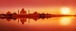 Panoramic view of Taj Mahal during sunset reflected in  Yamuna river, in Agra , Uttar Pradesh, India