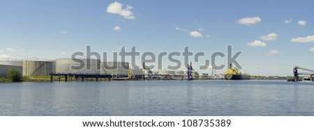 panoramic view of tanker and oil storage tanks in amsterdam harbor