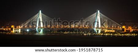 Panoramic view of the century bridge symbol of Haikou city illuminated at night in Haikou Hainan China ( translation : century bridge ) Сток-фото ©