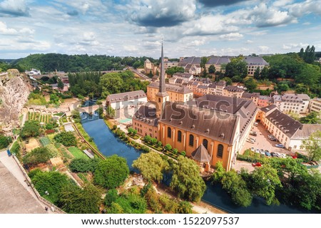 Panoramic view of the Church of St Jean du Grund and the old town in the valley of the river Alzette. Travel destinations in tiny country of Luxembourg Stock photo ©