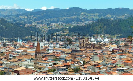 Panoramic view of the city Cuenca, Ecuador, with its many churches- Cathedral of the Immaculate Conception, church Santo Domingo, church Hogar Cristo Rey, church San Alfonso-and surrounding mountains