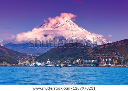 Panoramic view of the city Petropavlovsk-Kamchatsky and volcanoes: Koryaksky Volcano, Avacha Volcano, Kozelsky Volcano. Russian Far East, Kamchatka Peninsula