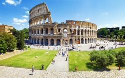 Panoramic view of the Colosseum and the homonymous square on a clear summer day, Rome, Italy.