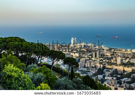 Panoramic view of the downtown Haifa and sea with ships in sunny summer day from upper terrace of Bahai gardens. Haifa, Northern Israel