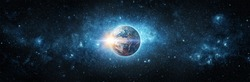 Panoramic view of the Earth, sun, star and galaxy. Sunrise over planet Earth, view from space. Concept on the theme of ecology, environment, Earth Day. Elements of this image furnished by NASA.