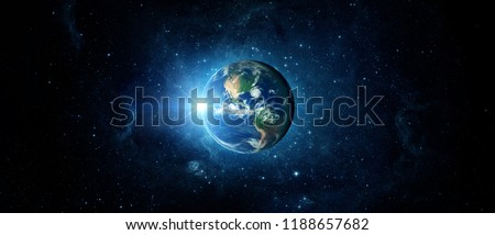 Panoramic view of the Earth, sun, star and galaxy. Sunrise over planet Earth, view from space.