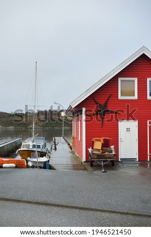 Panoramic view of the empty street near yacht marina, modern traditional house with tiled roof, falu red dye. Stavanger, Rogaland, Norway. Architecture, travel destinations, tourism, sailing, cruise Stock fotó ©