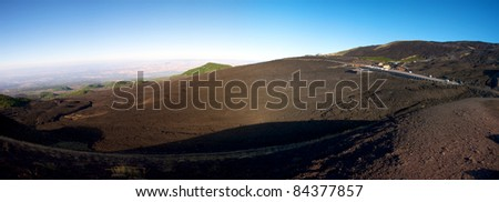 Panoramic view of the Etna early in the morning with a blue sky - stock photo