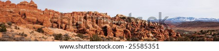 Panoramic view of the Fiery Furnace at Arches National Park with the La Sal Mountains in the background