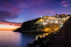 Panoramic view of the fishing village of The Cove at sunset in Salobrena, Granada Province, Andalusia, Spain