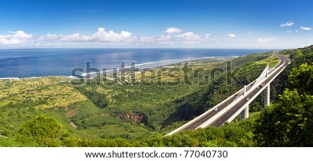 Panoramic view of the Grand Ravine Viaduct, which is a single-span bridge and part of the Route de Tamarins Road Development on Reunion Island