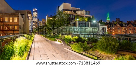 Panoramic view of the High Line promenade at twilight with city lights and illuminated skyscrapers. Chelsea, Manhattan, New York City #713811469