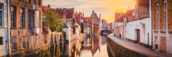 Panoramic view of the historic city center of Brugge in beautiful golden morning light at sunrise, province of West Flanders, Belgium