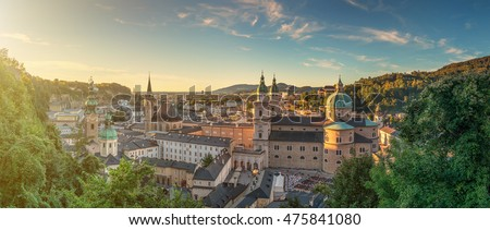 Panoramic view of the historic city of Salzburg with beautiful Salzach river from famous Hohensalzburg Fortress in golden evening light at sunset in summer, Salzburger Land, Austria