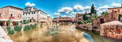 Panoramic view of the iconic medieval thermal baths, major landmark and sightseeing in the town of Bagno Vignoni, province of Siena, Tuscany, Italy