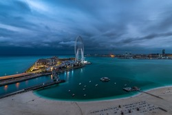 Panoramic view of the JBR beach and Bluewaters Island Dubai on a cloudy morning.