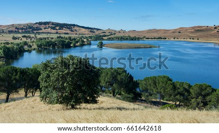 Shutterstock Panoramic view of the Lagoon Valley Park in Vacaville, California, USA, featuring the chaparral in the spring, with golden grass, and the lake