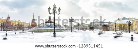 Panoramic view of the Manezhnaya or Manege Square in winter, Moscow, Russia. Central Moscow during snowfall. It is a tourist attraction in Moscow. Beautiful snowy cityscape near the Moscow Kremlin.