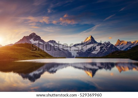 Panoramic view of the Mt. Schreckhorn and Wetterhorn. Popular tourist attraction. Dramatic and picturesque scene. Location place Bachalpsee in Swiss alps, Grindelwald valley, Europe. Beauty world.