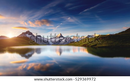 Panoramic view of the Mt. Schreckhorn and Wetterhorn. Popular tourist attraction. Dramatic and picturesque scene. Location place Bachalpsee in Swiss alps, Grindelwald valley, Europe. Beauty world. #529369972