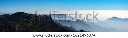 Panoramic View of the nature with mountains and clouds.