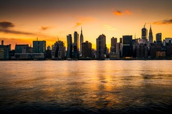 Panoramic view of the New York City skyline silhouette at sunset
