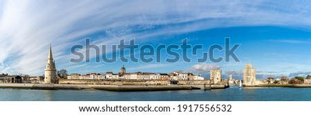 Panoramic view of the old harbor of La Rochelle on a sunny day with its famous old towers Photo stock ©