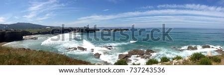 Shutterstock Panoramic view of the Os Castros Beach (Playa de los Castros) in Ribadeo, Galicia - Spain